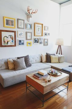 Tillary Tufted Sectional + Rustic Storage Coffee Table + Pillows from west elm