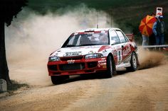 Didier Auriol and co-driver Denis Giraudet in their Mitsubishi Lancer Evo. III at Rallye Sanremo in 1996.