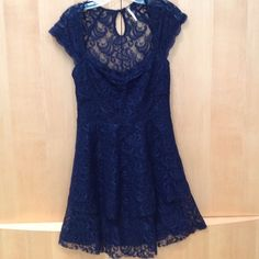 Free People Lace Dress Free People lace dress. Black underlay with lace overlay. Side zipper with small button closure at back of neck. Two tiered lace on bottom. Free People Dresses