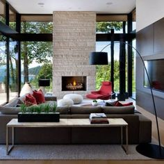 Small Living Room with Amazing Fireplace and Surround Windows