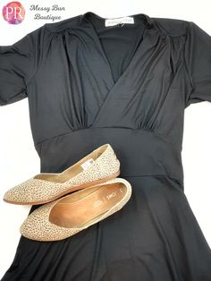 This little black dress has a retro vibe and pockets!  Grab your Paisley Raye Dahlia in the boutique now.