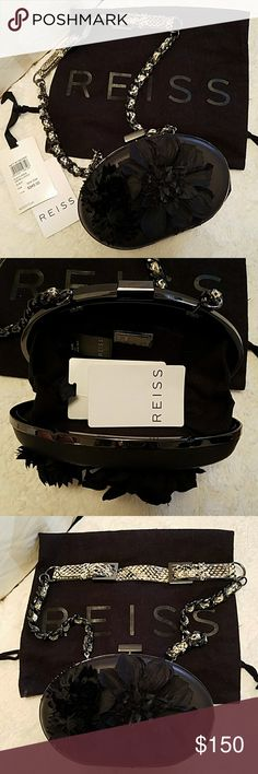 Cocktail bag with a shoulder strap by Reiss UK. The bag is made out of natural leather with  decorated flowers made out of fabric. The strap is removable. It's Reiss original cocktail bag.  Dust bag and tags  are included. Price is negotiable. Reiss Bags Mini Bags