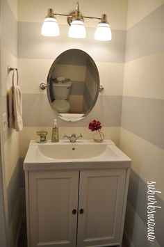 Half Bath Makeover - our pedestal sink is pretty, but i'd rather have this for storage and it looks nicer.