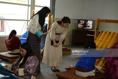 Japanese Princess Mako (C) watches weavers of Bhutanese traditional costumes at the Royal Textile Academy in Thimphu during her visit to Bhutan on June 3, 2017.Japanese Princess Mako, the oldest of Emperor Akihito's grandchildren, is on a nine-day official visit to Bhutan. / AFP PHOTO / DIPTENDU DUTTA        (Photo credit should read DIPTENDU DUTTA/AFP/Getty Images)