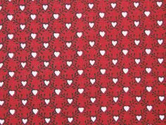 The original fabric is a block printed lining used in a christening gown form Furnes, Norway, of brocaded silk and painted taffeta. The red ground of the lining was probably produced as a reserve print, leaving the small hearts white, and then block printed in brownish black. The print can be dated to around 1800. Similar prints were produced in Denmark and that might be the origin also of this fabric.
