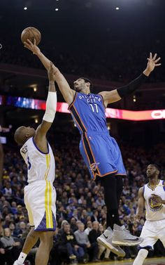 Oklahoma City Thunder's Enes Kanter (11) shoots over Golden State Warriors' David West (3) during the first half of an NBA basketball game Wednesday, Jan. 18, 2017, in Oakland, Calif. (AP Photo/Marcio Jose Sanchez)