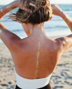 This shimmering back tat. | Community Post: 24 Metallic Tattoos That Will Give You Life This Summer