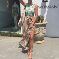 Gabby at Zimmermann Melrose Place wears the Anais Wrap Top, Anais Antique Floral Split Pant, Beach Shoulder Hobo and Loop Knot Ankle Tie Heel.
