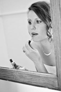 putting on the last finishing touches! #WeddingPhotographyPackages #MinneapolisBridalHairandMakeup