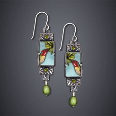 Trochilus Anna Hummingbird Earrings by Dawn Estrin. Beautifully colored Trochilus Anna Hummingbird takes nectar from a tropical flower. Sterling silver, Swarovski crystal, freshwater pearl. Image printed on archival paper and protected with a beveled scratch-resistant polycarbonate plastic.