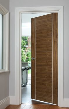 Orense Walnut (FD30) bespoke door - contemporary style door features stunning stainless steel inlays will be perfect for modern homes
