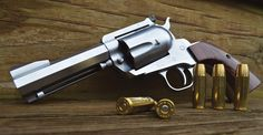 A .500 JRH Blackhawk with 4½-inch octagon barrel, fluted five-shot cylinder, modified XR3-RED grip frame with custom walnut grips, and finished in hard chrome. A Bowen Rough Country rear sight adorns the revolver.