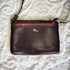 COACH Crossbody Purse This is a medium size Crossbody from COACH. It has a removable pocket that is metallic maroon and the purse itself is a deep plum or maroon color with gold accents. It is in like new condition! Coach Bags Crossbody Bags
