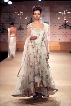 Stunning white anarkali frock with works of gold.
