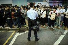 Umbrella Revolution Hong Kong, Police forces guard a protest on Sai Yeung Choi Street at Mongkok district on November 27, 2014 in Hong Kong, Hong Kong. Amid clashes, hundreds of Hong Kong police cleared the Mong Kok pro-democracy protest site on November 26, dispersing protesters and reopening roads and intersections blocked for almost two months. Approximately 80 protesters were arrested including student leaders Joshua Wong and Lester Shum. (Photo by Alexander Koerner/Getty Images)