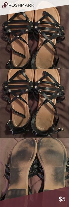 Black gladiator sandals size 8.5 Black gladiator sandals size 8.5.  Extremely used and reflected in the price. Shoes Sandals