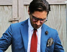 From the glasses to the jacket to the bold pocket square, this guy has great style.