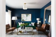 Grab a Roller These Are the Best Small Living Room Paint Colors is part of Living Room Colors Blue - Find out which 10 small living room paint colors interior designers choose to make a space look bigger than it really is Dark Living Rooms, Living Room Green, Living Room Sofa, Modern Living, Apartment Living, Studio Apartment, Blue Velvet Sofa Living Room, Blue And Gold Living Room, Dining Room