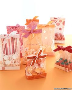 Colorful Bags - Dress up cellophane bags with decorative paper to showcase candy for favors or guest-room gifts. Candy Wedding Favors, Candy Favors, Edible Favors, Candy Bags, Favours, Red Wedding Decorations, Paper Decorations, Christmas Gift Baskets, Christmas Bags