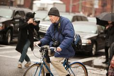 Bill Cunningham makes a bike so badass. Photographed by Mark Iantosca #refinery29 http://www.refinery29.com/mens-fashion-week/street-style#slide-13