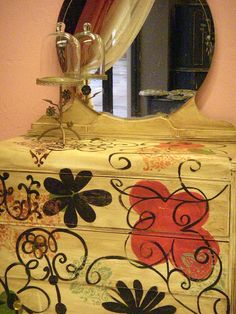 Painted dresser, I like the mustardseed yellow. The bright orange would clash w/the mohaugany curtains