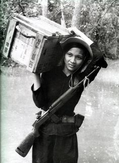 A female Viet Cong soldier carrying supplies.