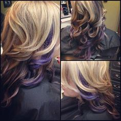 Curly blonde hair with purple peek-a-boo highlights.
