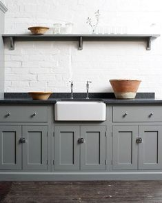 Thinking about a black countertop and colored cabinets...