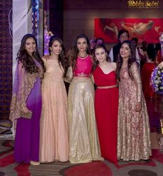 Cocktail gowns and Lehenga fashion for the indian wedding reception. Indian Wedding Party Dresses, Indian Wedding Bridesmaids, Couple Wedding Dress, Indian Bridal Outfits, Indian Gowns Dresses, Wedding Dresses For Girls, Girls Party Dress, Wedding Dress Styles, Cocktail Party Outfit