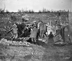 WWI, Feb 1918; Canadian Artillerymen getting their gun into position. Library and Archives Canada MIKAN no. 3405471