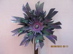 Upcycled tin can flowers. $25.00, via Etsy.