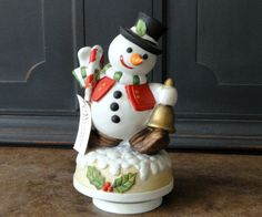Check out this item in my Etsy shop https://www.etsy.com/listing/204404213/vintage-porcelain-snowman-music-box