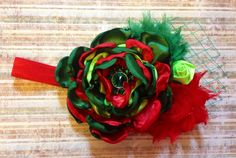 Satin cinged flower with shabbies, can come on either a clip or headband!