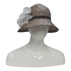 Cloche hat for spring and summer. This Cloche hat is a part of our Signature Collection. The Signature Collection Cloche features classic hat styles.This Hat is adorned with a silk rose in shades of c
