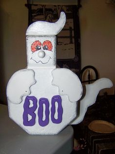 Ghost hallowing decoration made of concrete and wood. $25.00, pso4112000@yahoo.com
