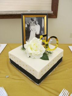 Very simple and small cake for my parent's 50th wedding anniversary party. This was the couples cake.  We also had sheet cakes, several different varieties of cupcakes.
