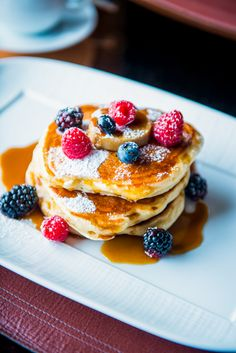 The fluffiest american pancakes with fresh berries and syrup