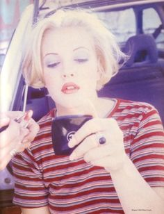 Drew Barrymore circa the 90s.oh lord I remember the overtweezed brow and lilac eyeshadow/red lip combo well! Find us on facebook at https://www.facebook.com/JNLondon