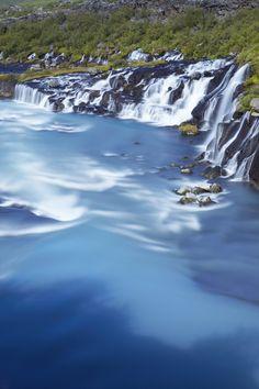 Hraunfossar waterfalls on volcanic rocks formed from lava flow, Borgarfjorour.