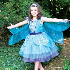 DRagonfly Fairy Costume.A shimmering costume in turquoise and purple tones. Float like a dragonfly with the hanging glittering wings. Includes a pretty hairband. Available in sizes 3-5 years, 6-8 years and 9-11 years. www.blushfashions.com