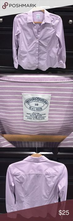 Fitted brooks brothers women's dress shirt 10 This is a fitted cotton non-iron dress shirt in size 10 from Brooks Brothers. This was worn one time and I've been hanging in my closet. No rips stains or tears. Pet free and smoke free home. Brooks Brothers Tops Button Down Shirts