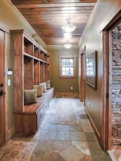 Good design example for mud room - tile on floor, wood built-ins, wood trim and doors. Future House, My House, Farm House, House Wall, Log Homes, My Dream Home, Home Remodeling, House Plans, Sweet Home