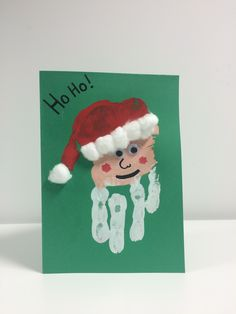 Santa Hand Print Card - this uses the hand print, but this time upside down! Print onto green card for the full effect in white. When dry, paint a sort of flesh colour at the top for Santa's face and a red hat with cotton wool balls to make the furry part of the hat. Done!