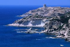 The rugged coastline of Costa del Sud with a Spanish tower perched high on a cliff