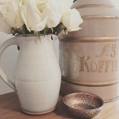 Meghan Markle decor style.. vintage coffee tin repurposed as dog food container.. #home #decor #doggietreats #flowers