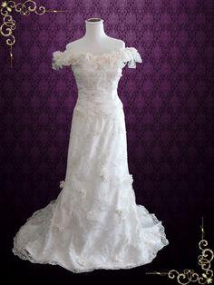 Vintage Inspired Unique Lace Wedding Dress with Off Shoulders Neckline https://www.ieiebridal.com/collections/vintage-style-wedding-dresses #VintageWeddingDress