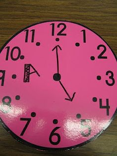 """I spy... {time} Put the clocks around the room and have your students walk around with a clipboard """"spying"""" the analog clocks and writing the digital times on their recording sheet."""