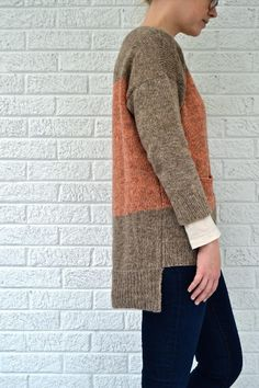 A block of color and a pocket set the playful mood of this simple and modern pullover. Oversized fit, bracelet sleeves, and a longer hem in the back make it fresh and easy to wear! Find this pattern and more inspiration at LoveKnitting.Com.