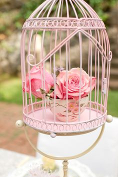 Birdcages filled with vintage tea cups and roses. Looks like the rose from beauty and the beast!