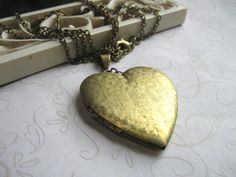 Vintage heart locket necklace  with long brass by botanicalbird